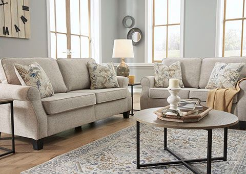 How to Decorate Around a Beige Couch?