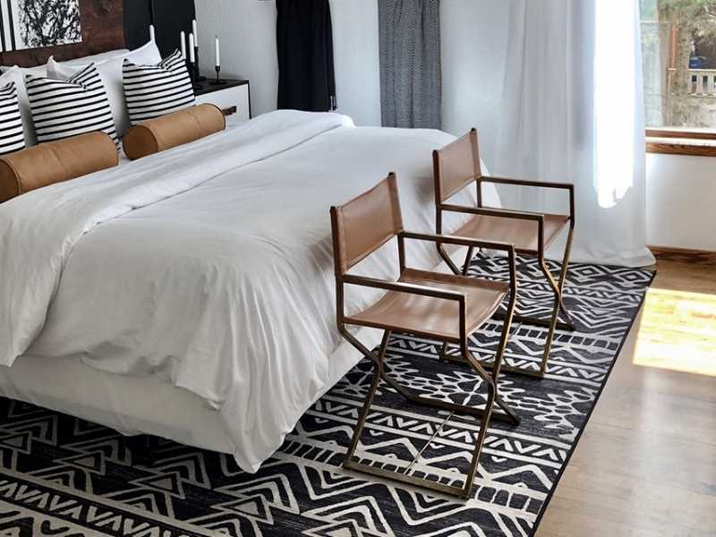 How to Slide a Rug Under a Heavy Bed?